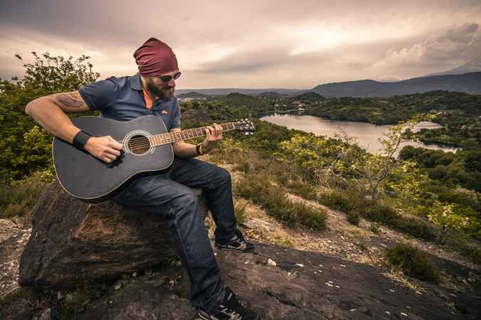 adult beard countryside guitar